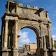 Monumental arch in Djemila set against a blue African sky